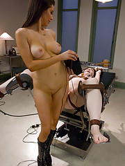 Hot brunette is shocked and strap-on fucked by nurse in medical play scene