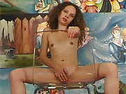 Horny teenager pleasuring herself on a chair