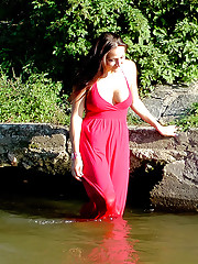 Teenage hottie swimming in public in a river