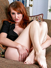 Redhead with big titties slips off her jeans and masturbates at Anilos