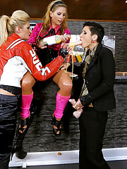 Fetish chicks playing with cream at the bar
