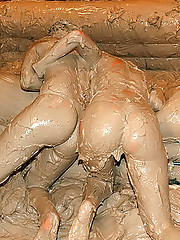 Crazy hot wild babes wrestling in a muddy pit