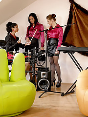 Hot clothed horny lesbian action on a chair