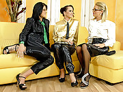 Three attractive lesbians on a yellow couch