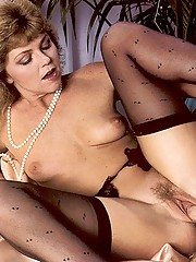 Seventies lady in stockings enjoys a big cock