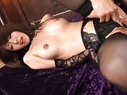 Miho Imamura Asian in black stockings gets oil and dong on pussy