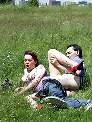 Old guy screwing young chick in an open field