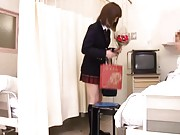 Japanese AV Model shows ass in white scanty and skirt to patient