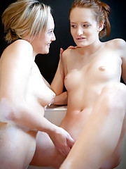 Denisa and Linda take it slow, gently and tenderly coaxing each other through foreplay and a whimsical, playful bubble bath on their way to multiple quivering orgasms.