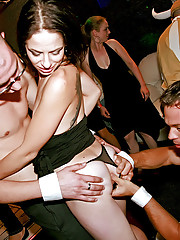 Chicks fucking and sucking a sailor at a club