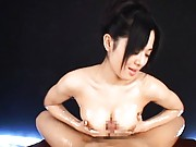 Sora Aoi Asian rubs phallus between big and full of lotion cans