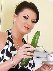 Porn chick inserting cucumber into her pussy