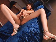 Erika Satoh Asian with fine ass fucks her poonanie with dildos