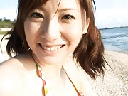 Yuma Asami Asian with big jugs in bra shows sexy curves on beach