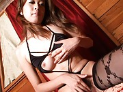 Risa Misaki Asian with black stockings and bra rubs her poonanie