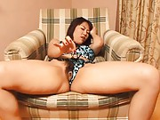 Rei Himekawa Asian in satin lingerie teases clit with sex toy