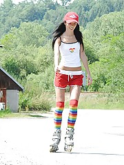 Roller skating babe plays with cooch outside