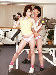 Two very hot lesbians at the gym working out
