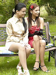Three sexy clothed girls playing in backyard