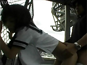 Horny chap banging asian hottie on a rooftop