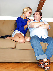 A blonde beauty sucks an old penis indoors