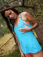 Gorgeous brunette stroking cooch in the woods