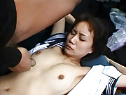 Asian sweetheart screwing in a car publicly