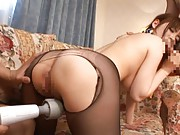 Nao Mizushiro Asian has peach licked through black nylon stocking