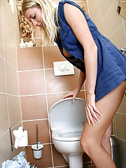 Babe on a toilet stroking cooch for pleasure