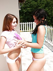 Lesbian brunettes licking pussies outdoors