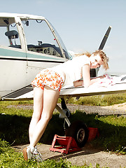 Hot sweetie fondling herself near an airplane
