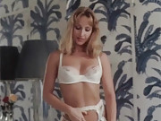 Gorgeous retro beauty masturbates in her bed