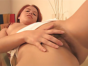 Girl with pigtails rubbing snatch with finger