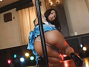Yuka Osawa Asian in blue dress and high heels dancing at the bar