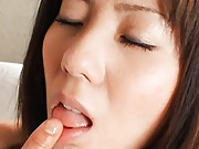 Yuma Asami Asian takes finger that touches her lips in mouth