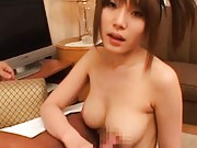 Saki Tsuji Asian rubs hard phallus of her generous nude hooters