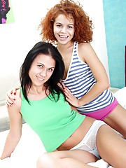 Two teenage bed jumping babes fooling around