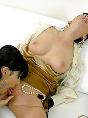 Clothed pretty lesbians fondling each other