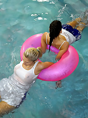 Two very horny lesbians swimming in a pool