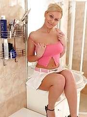 Cute chick washing large fun bags with soap