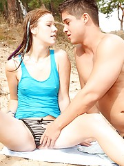 Dude nailing a hot teenage diver on the beach