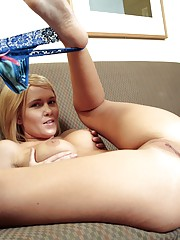 Blonde massaging her perfect body with hands