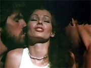 Annette Haven giving double handjob to 2 guys