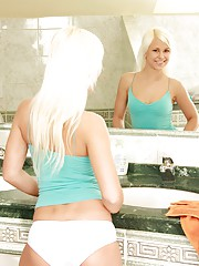 A very blonde babe in the bathroom stroking