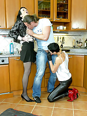 Hotshot banging two clothed babes in kitchen