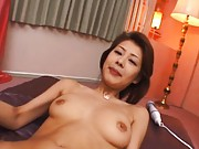 Sakurako Asian with big round cans has pussy under vibrator