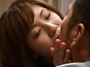 Yuma Asami Asian has some red wine after serving dinner to dude