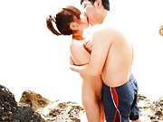 Rico Yamaguchi Asian all naked is kissed and caressed on beach