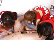 Yuu Konishi Asian with two cheerleaders play with same joystick