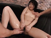 Nana Nanaumi Asian with oiled body is aroused with vibrator